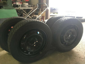 """Winter Tires set of 4 mounted on 16"""" rims"""