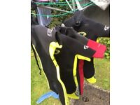 Selection of children's short sleeve wetsuits sizes from about 5 to 9 years I think