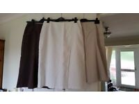 Bundle of 3 NEXT skirts in size 12. One in brown moleskin and two others in white and biege linen