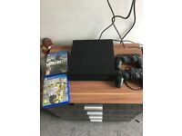 PlayStation 4 slim, 2 controllers and 2 games
