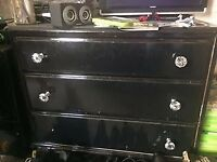 black chest of draws and 2 bedside draws