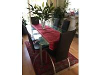 Glass dining room table with chairs