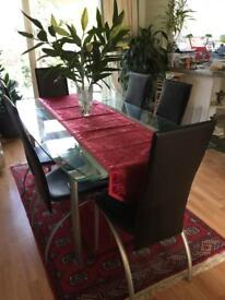 Next black high gloss dining table and chairs Sold pending pick
