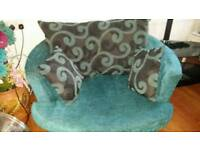 Teal cuddle/swivel sofa chair