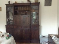Free standing wall unit with display and storage cupboards and glass lined drinks cupboard and shelf