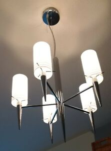 two identical chrome chandeliers