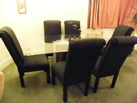 Smoked glass Dining Table, marble type base and 6 high backed Italian chairs