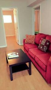 Three seater  big sofa/couch in a good condition with coffee tab
