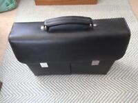 Dicota leather laptop bag