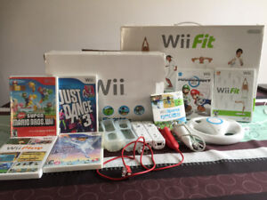 Wii SPORTS EDITION PLUS WII FIT AND BOARD MARIO KART ETC.