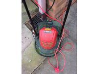 "Lawn Mower by ""Sovereign"". Electric. Roughly 1 year old, great working order."