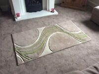Brown/Beige rug with cream and green swirl effect