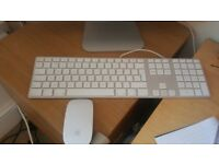 Imac monitor with mouse and keyboard
