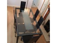 Dining table & 6 chairs for sale (barely used).