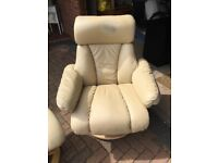 Cream leather reclining arm chair and matching foot stool
