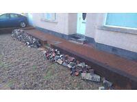 Bricks and scrap metal fence