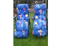 TWO PADDED RECLINING GARDEN CHAIRS