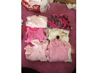Different size baby girl clothes and shoes