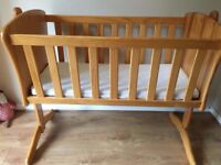 Rocking Cot - excellent condition - being sold due to surprise twins (includes new mattress)