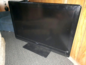 52 inch Phillips tv with black glass stand