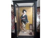 Japanese lady in glass display.