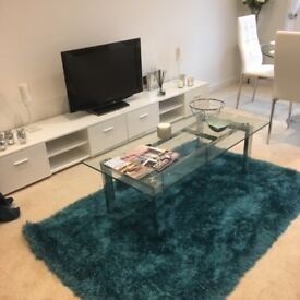 Clear glass and chrome coffee table