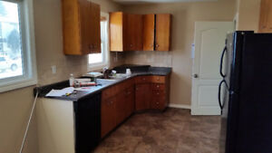 Rent or rent to own house with suite in Penhold
