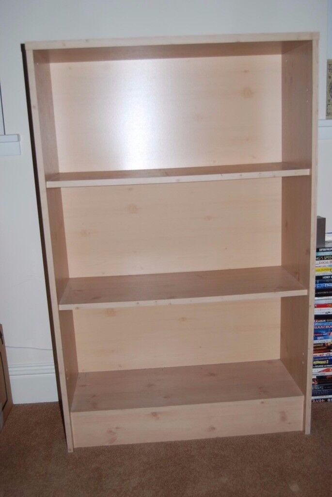"""Bookcases for sale, three shelves and backing panel, with washable melamine wood effect finishin GlasgowGumtree - 6 identical bookcases, 4ft 3"""" tall by 2ft 9"""" wide by 1ft 1"""" deep. Can be sold singly or as a set. Good condition. £10 EACH OR £50 THE LOT"""