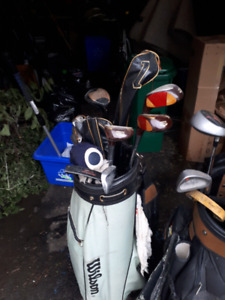2 bags and assorted golf clubs