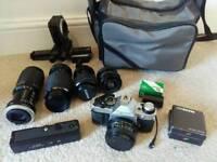 Canon AE-1 program, lenses and case.