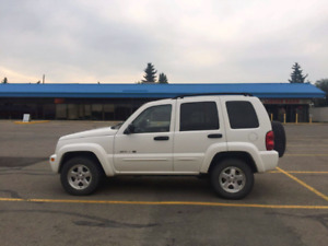2002 jeep liberty limited with remote car starter.