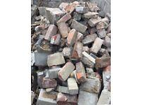 Red brick, breeze block, sandstone / hardcore