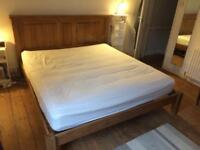 Solid Oak super king bed frame with mattress and bedding