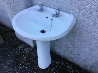 White used wash basin and pedestal