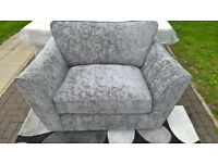 A New Alexis Grey Fabric Material Snuggle Arm Chair.