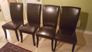 4 Simpli Home Black Letherette chairs