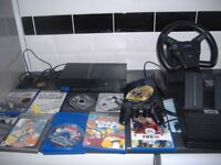 sony playstation 2 with steering wheel and pedals controller and 10 good games