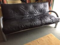 Genuine Black leather sofa bed with metal frame.