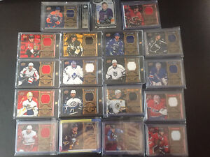 16/17 Tim Hortons Jersey Relic hockey cards with Mackinnon auto