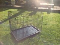 Black metal, plastic coated Pet Cage. With plastic removable tray.