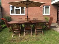 Teak garden table and 8 chairs