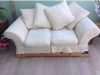 CREAM D.F.S TWO SEATER CUSHION BACK SOFA IN EXCELLENT CONDITION