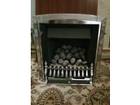 Gas fire with marble and wood surround