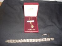 silver gate leg braclet 6 inch in lenght and gold heart pendant