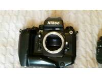 Film camera nikon f4s with macro and telephone photo sigma lenses