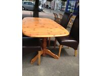 Pine extending table and 4 faux leather chairs