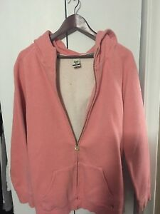 Light pink TNA (aritzia) zip-up hoodie.