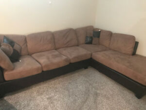 2 piece sectional couch - $550 o.b.o. (14 months warranty left)