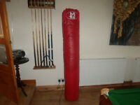 B2 Red punch bag (165cm long, 30 cm diameter) VGC. BBE pair boxing gloves, new condition.