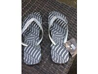 Brand new Silver Havaianas flip flops. Size 44 (UK 11) £10 or near offer.